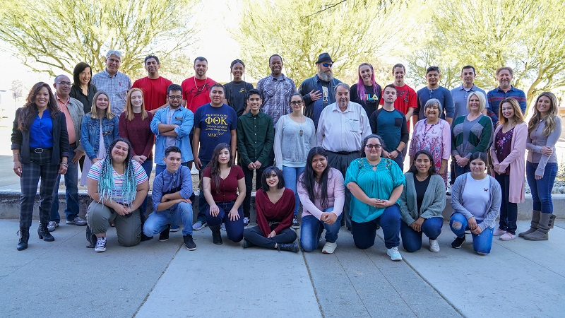 Honors Enrichment Program students, faculty and staff standing outside on campus