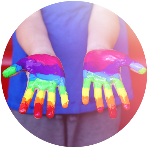 hand with different colors of paint on the fingers